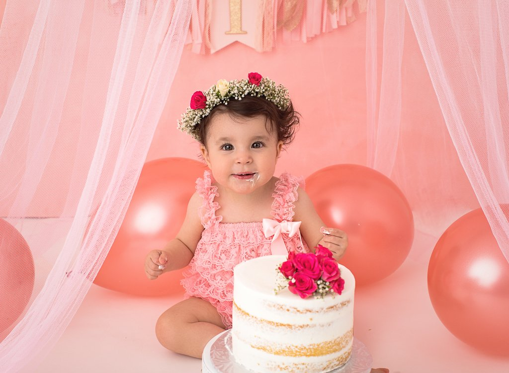 1st birthday cake smash session with a beautiful pink decor